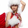 Studio portrait of a sexy young brunette woman dressed as Santa — Stock Photo