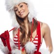 Beautiful Christmas woman in red santa hat holding Xmas decorati — Stock Photo #6845448