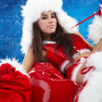 Beautiful sexy girl wearing santa claus clothes — Stock Photo #6845590