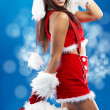 Stock Photo: Beautiful sexy girl wearing santa claus clothes
