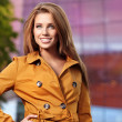 Beautiful young woman in autumn city — Stock Photo #6860429