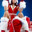 Portrait of beautiful sexy girl wearing santa claus clothes — Stock Photo #6860604