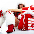 Portrait of beautiful sexy girl wearing santa claus clothes — Stock Photo #6860662