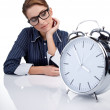 Bored woman at her desk at the end of the day — Stock Photo