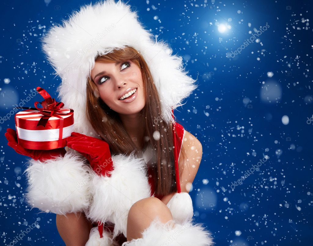 Winter portrait of a santa  woman with a christmas gift   Stock Photo #6876001