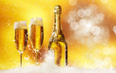 New Year champagne in the snow — Stock Photo