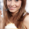 Stock Photo: Young happy woman with cake at home