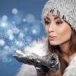 Woman Blowing Snow — Stock Photo #7156588