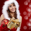 Stock Photo: Sexy girl holding a gift in packing