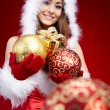 Cute young girl with christmas balls — Stock Photo #7156990