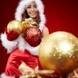 Cute young girl with christmas balls — Stock Photo #7157153