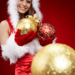 Cute young girl with christmas balls - Stock Photo