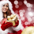 Young woman with Christmas present — Stock Photo #7157645