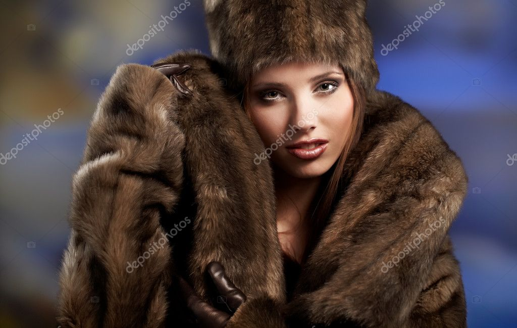 Beautiful woman in a fur coat   Stock Photo #7191198