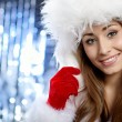 Young christmas woman over silver background — Stock Photo #7225837