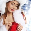 Young christmas woman over silver background — Stock Photo #7225895