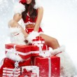Attractive young christmas women with the gift — Foto de Stock