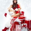 Attractive young christmas women with the gift — Stock fotografie