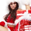 Attractive young christmas women with the gift — Stock Photo #7228976