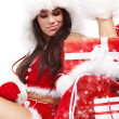 Attractive young christmas women with the gift — Stockfoto