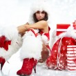 Attractive young christmas women with the gift — Stock Photo