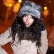 Smiling  woman in winter night city, snow background — Stock Photo