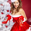 Christmas Woman getting shoes as gift. — Stock Photo #7436983