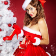 Christmas Woman getting shoes as gift. — Stock Photo #7437076