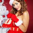 Christmas Woman getting shoes as gift. — Stok fotoğraf #7437196