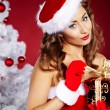 Beautiful sexy girl wearing santa claus clothes — Stok fotoğraf #7438706