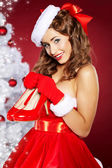 Christmas Woman getting shoes as gift. — Stock Photo