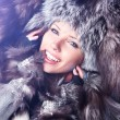 Winter wild woman on snow — Stock Photo
