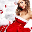 Portrait of beautiful sexy girl wearing santa claus clothes — Stock Photo #7466532