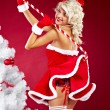 Happy cute girl in santa claus suit over red background — Stock Photo #7466861