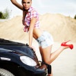 Young sexy woman with her broken car. — Stock Photo