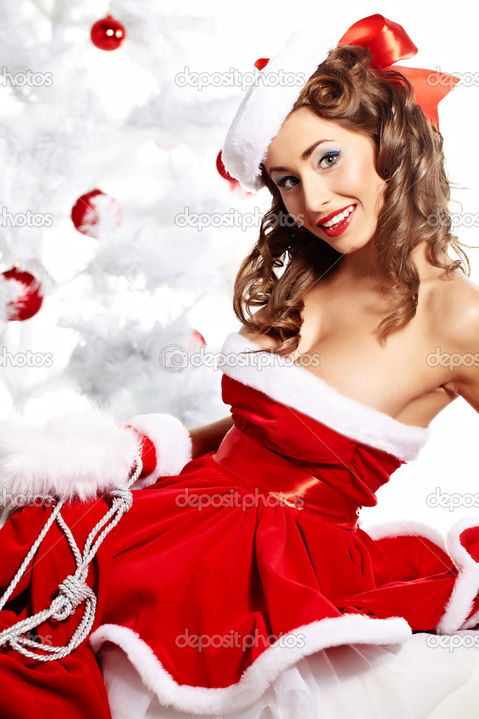 Portrait of beautiful sexy girl wearing santa claus clothes   Stok fotoraf #7466532