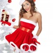 A pretty woman at Christmas holding her presents — Stock Photo