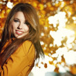 Young brunette woman portrait in autumn field — Stock Photo
