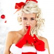 Pin-up sexy girl wearing santa claus clothes — Stock Photo #7562773