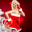 Pin-up sexy girl wearing santa claus clothes — Stock Photo #7562832