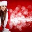 Beautiful sexy girl wearing santa claus clothes — Stock Photo #7581408