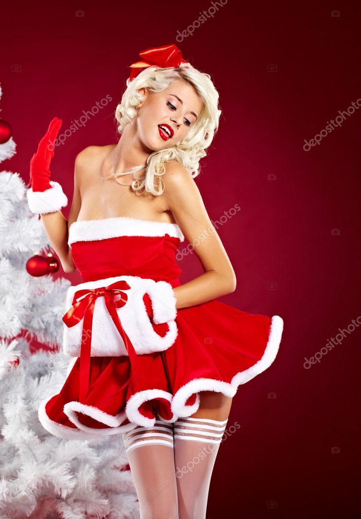 Pin-up sexy girl wearing santa claus clothes — Stock Photo #7599650