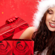 Happyl young woman with christmas gift box — ストック写真