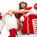 Christmas girl with gifts — Stock Photo