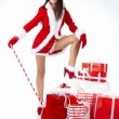 Christmas woman with gifts — ストック写真