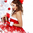 Stock Photo: Fashionable young woman in Santa Claus clothes with presents