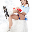 Beautiful young pin-up woman going to ice skating — Stock Photo