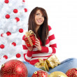 Beautiful girl with gift box next to white christmas tree — Stock Photo #7861829