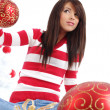 Beautiful girl with gift box next to white christmas tree — Stock Photo