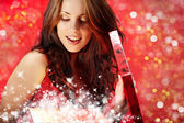 Sexy girl smiles and holding a magic gift in packing — Stock Photo
